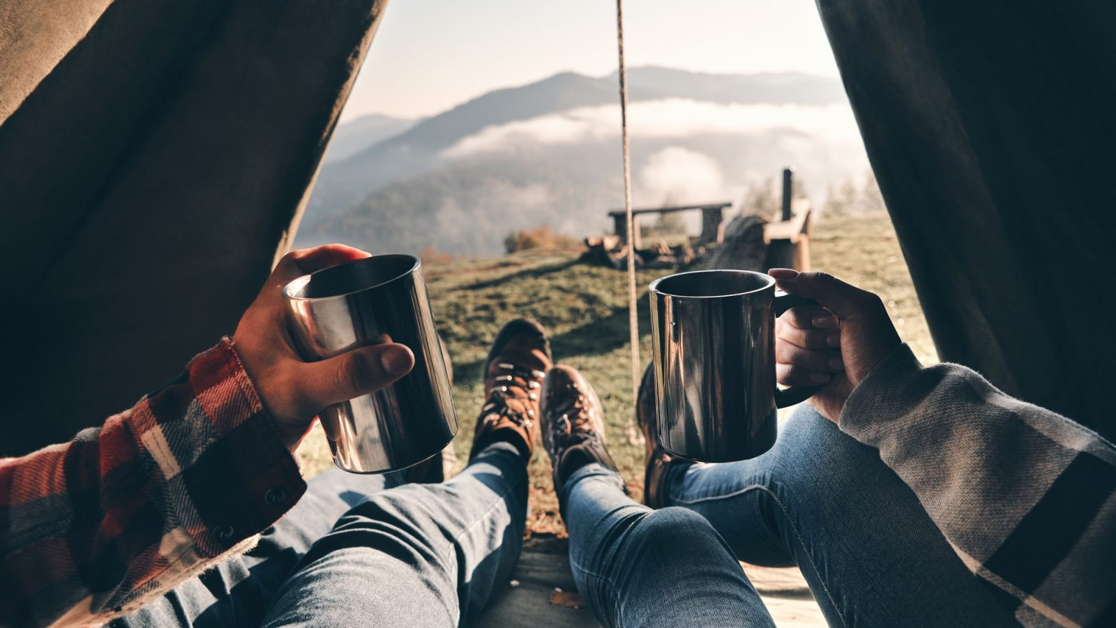 Having hot drinks inside camping tent.