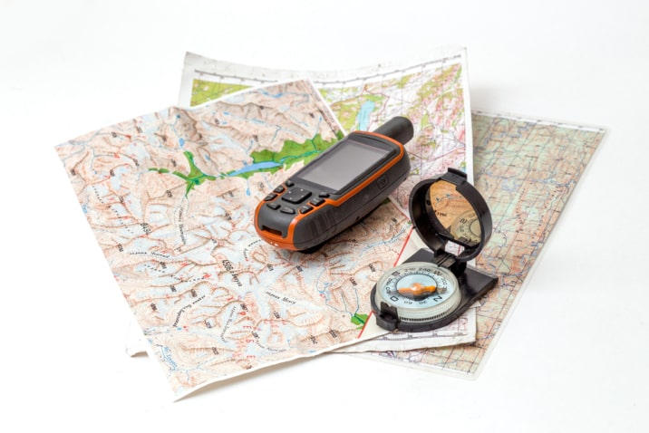 GPS device and compass on a map.