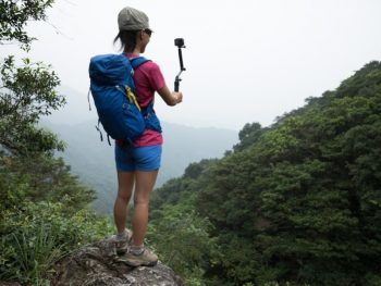 backpacker with action camera