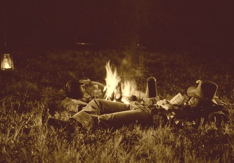 cowboy asleep by the campfire
