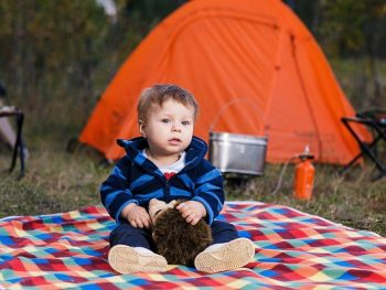toddler at campsite