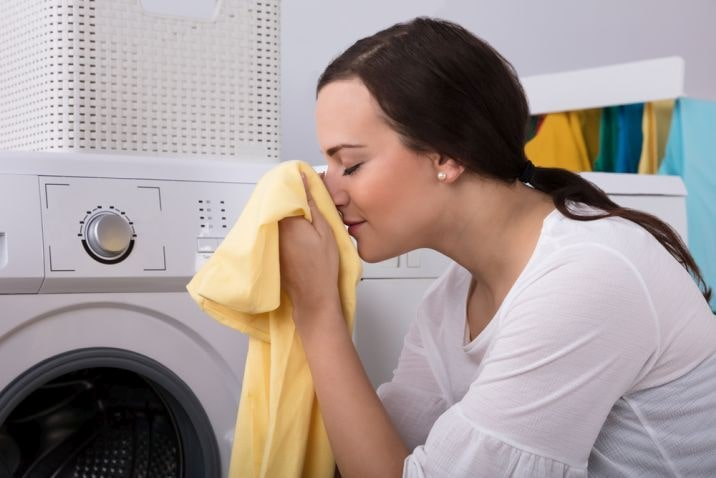woman smelling laundry