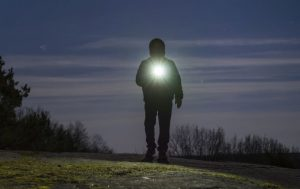 man with flashlight for camping