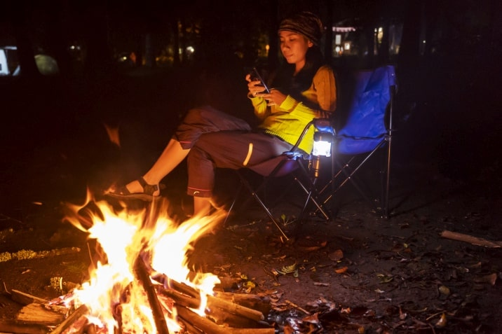 using cellphone by campfire