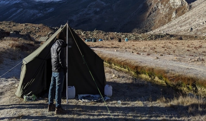 canvas tent in front of mountains