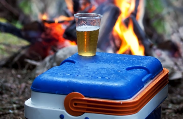 cooler and cup of beer